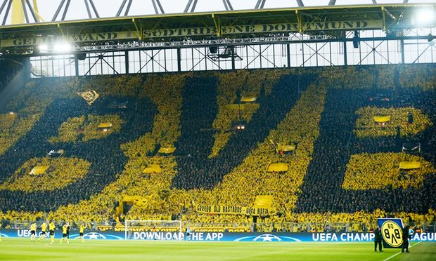 Borussia Dortmund fans wore ponchos to create the club's BVB crest