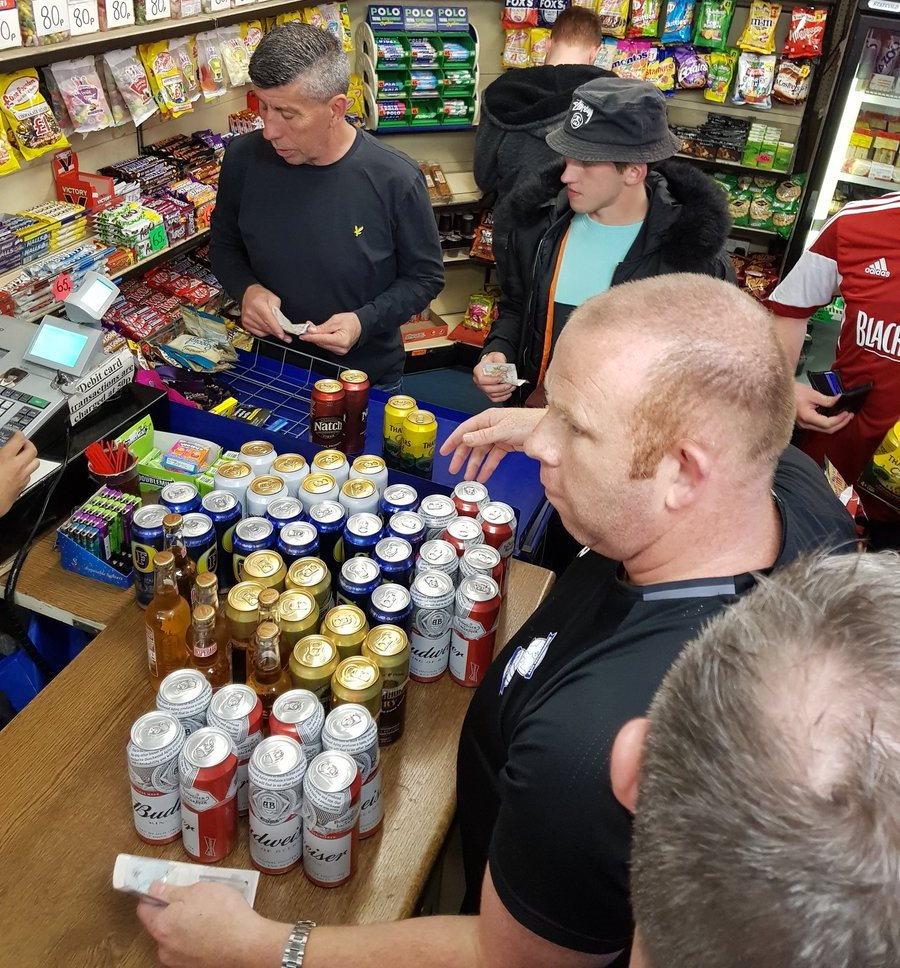 Brum kit man in the offy buying beers for the team bus
