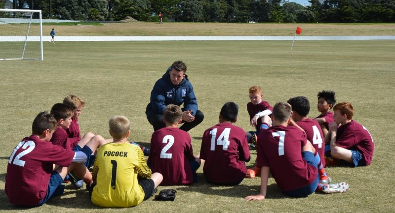 Kane coaching a Sacred Heart College junior side at the AIMS Games