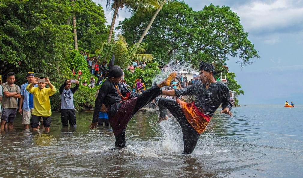 People take part in Silat, a traditional martial art west Sumatra
