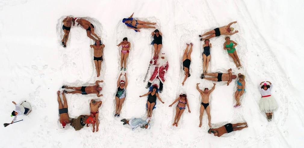 Cryophile winter swimming club of Siberia form their bodies into a 2018 sign