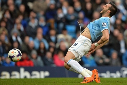 Manchester City's Spanish striker Alvaro Negredo reacts as he goes down after being fouled by Fulham's Venezuela defender Fernando Amorebieta (unseen) for a penalty leading to the opening goal during the English Premier League football match between Manchester City and Fulham at the Etihad Stadium in Manchester, northwest England, on March 22, 2014.  AFP PHOTO / PAUL ELLISRESTRICTED TO EDITORIAL USE. No use with unauthorized audio, video, data, fixture lists, club/league logos or live services. Online in-match use limited to 45 images, no video emulation. No use in betting, games or single club/league/player publications.PAUL ELLIS/AFP/Getty Images