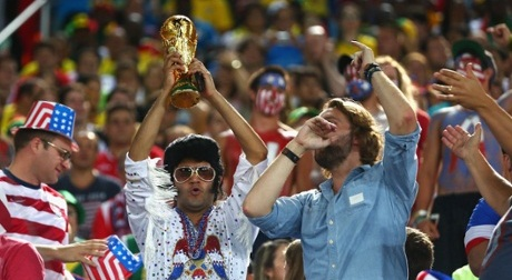 NATAL, BRAZIL - JUNE 16:  A United States fan dressed as Elvis holds up a replica of the World Cup trophy during the 2014 FIFA World Cup Brazil Group G match between Ghana and the United States at Estadio das Dunas on June 16, 2014 in Natal, Brazil.  (Photo by Michael Steele/Getty Images)
