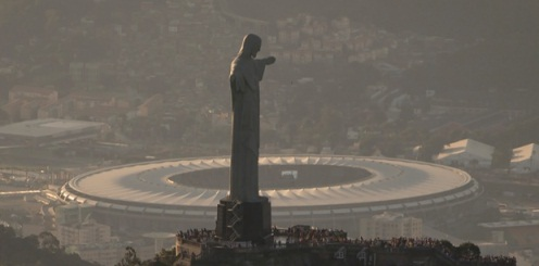 The Maracana stadium is seen behind the Christ the Redeemer statue in Rio de Janeiro, Brazil, Sunday, June 8, 2014. The Word Cup soccer tournament is set to begin in just a few days, with the opening match on June 12 and Maracana stadium will host the World Cup Final match on 13 July. (AP Photo/Felipe Dana)