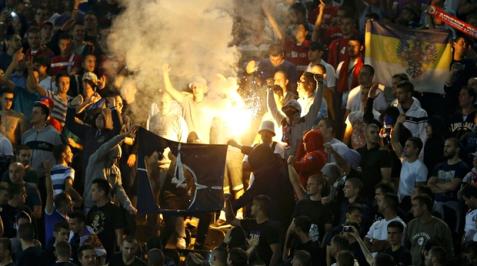 Serbia burn NATO flag