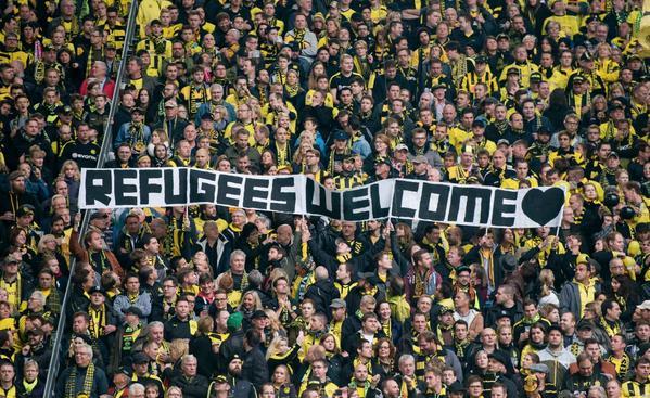 German football fans welcoming refugees