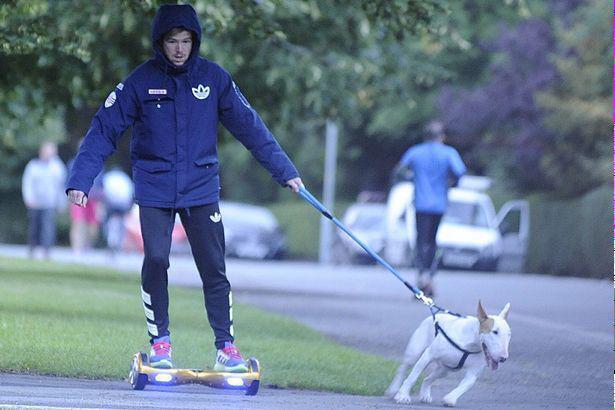 Alberto Moreno walking the dog