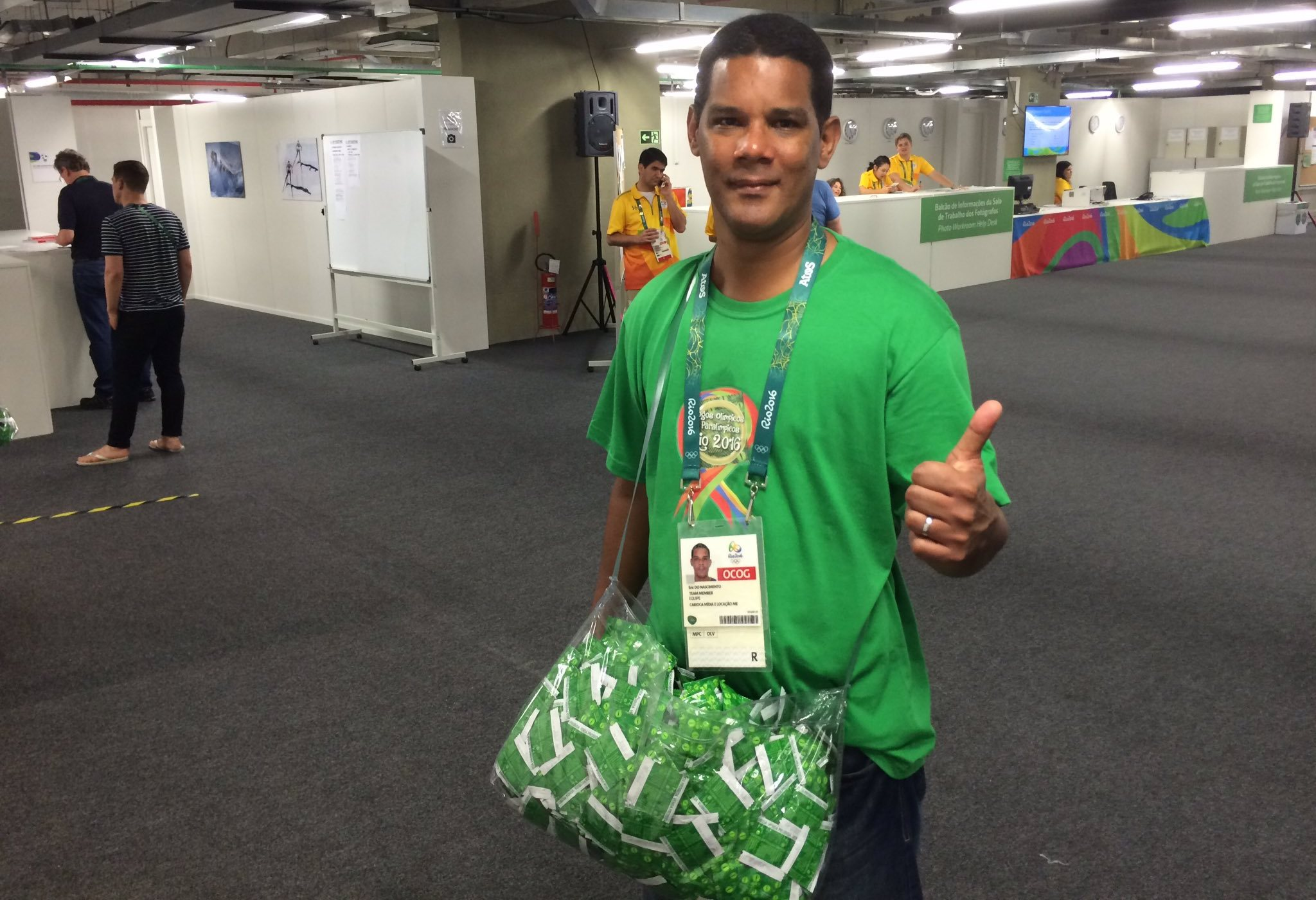 Meet Eric, the guy whose job it is to walk around the Olympics with a big sack of condoms