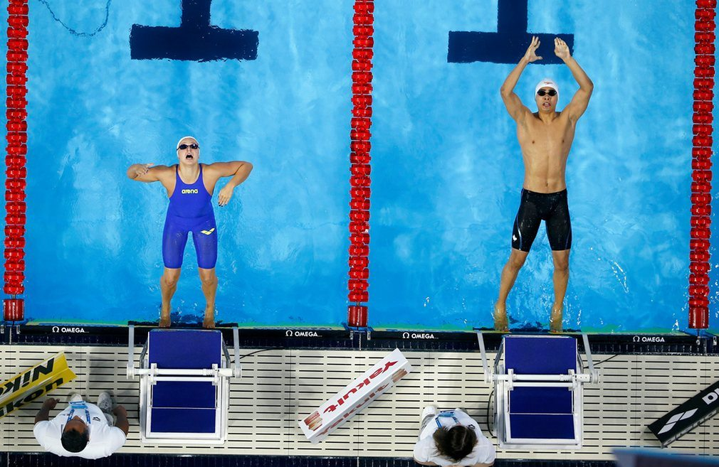 fanny-teijonsalo-of-finland-left-and-javier-acevedo-of-canada-compete-in-the-mixed-4x50m-medley-relay-heats
