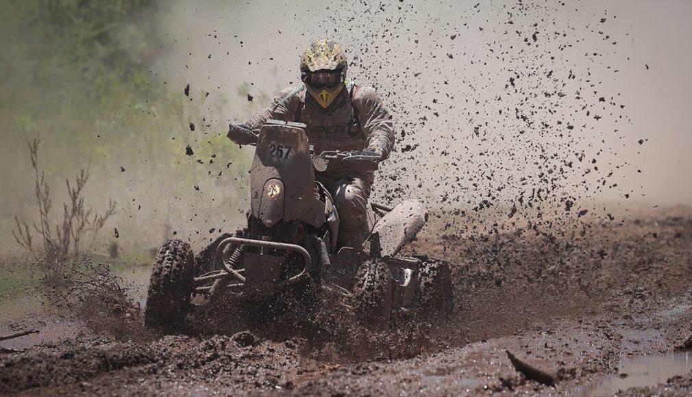 Mazis Dakar Team's Kees Koolen gets muddy on his TRX680 Honda quad.