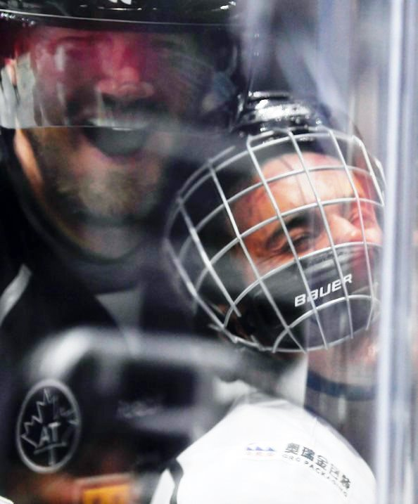 Chris Pronger squashing Justin Bieber into the boards