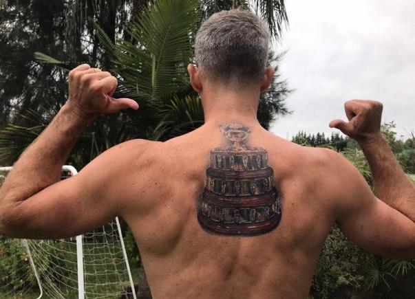 Argentina's Davis Cup captain Daniel Orsanic kept his word and tattooed the trophy on his back