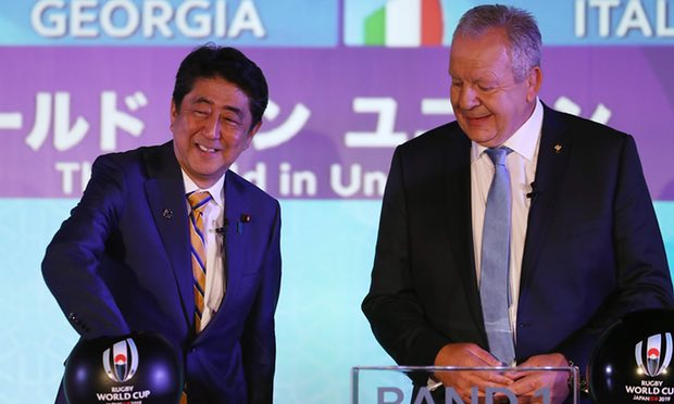 Bill Beaumont looking on, Japan's Prime Minister Shinzo Abe