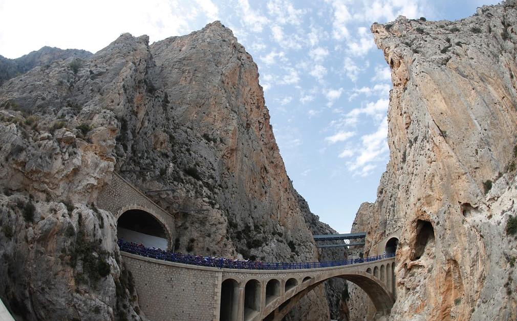 The pack traverse a bridge during the ninth stage 174km between Orihuela and El Poble Nou de Benitatxell in Spain