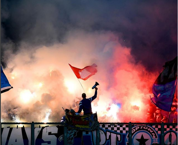Hamburg fans light fireworks during their Bundesliga match against Schalke 04